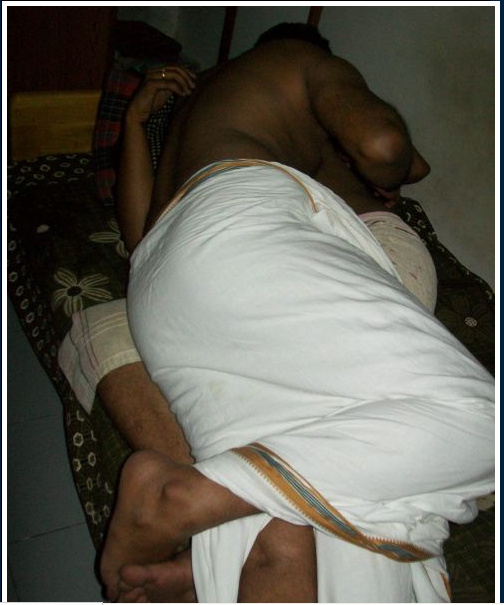 Indian gay photo of a sexy south indian hunk stripping his lungi and jerking off