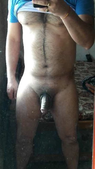 Naked hairy hunk gets hard in nude pics