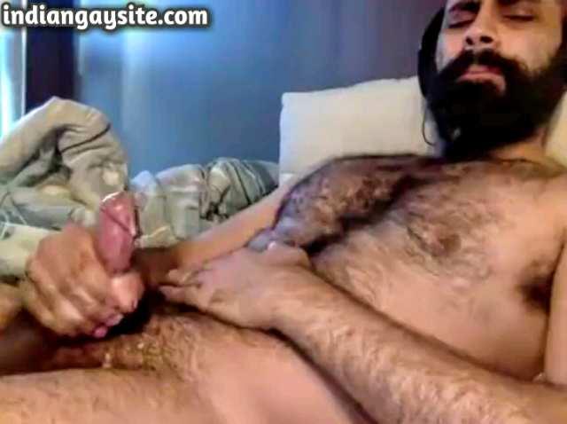 Indian gay video of a horny Punjabi hunk masturbating and cumming hard on cam
