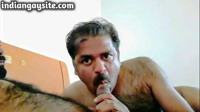 Indian gay blowjob video of two married desi mature men having fun away from their wives