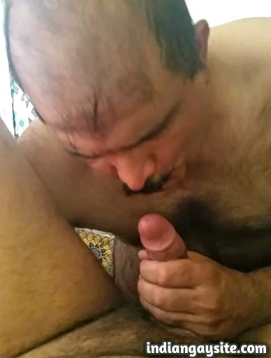 Indian gay blowjob video of a horny mature Pathan sucking his neighbour's circumcised dick
