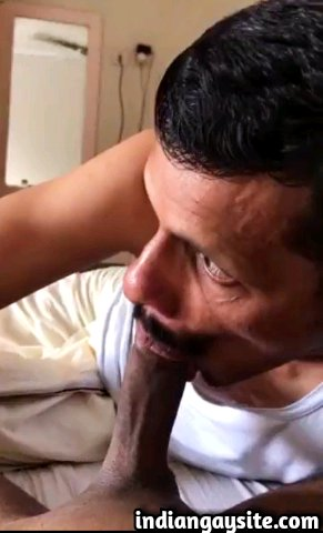 Indian gay blowjob video of a horny mallu man sucking his friend's big and hard cock