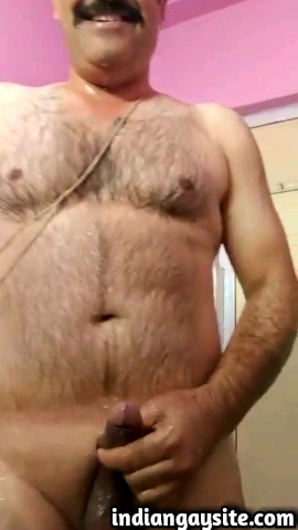 Indian gay video of a horny mature desi man bathing naked and jerking off