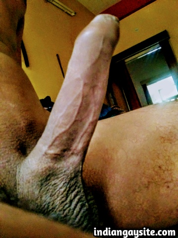 Indian Gay Porn: Sexy desi hunk showing off his big and uncut cock