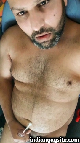 Indian gay video of a sexy desi daddy bear jerking off naked and cumming heavily all over himself