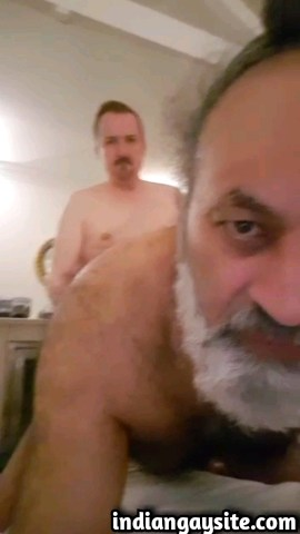 Amateur gay sex video of a horny and mature Punjabi daddy getting fucked bare by his white neighbour