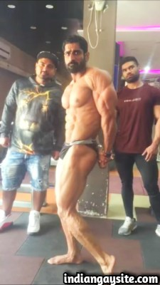 Sexy desi hunk flexing his muscles in tight briefs
