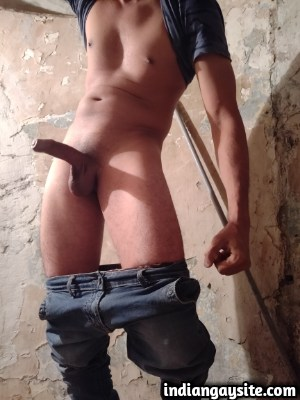 Sexy desi hunk stripping naked on a staircase