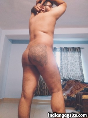 Sexy desi hunk exposes smooth tattooed bubble butt