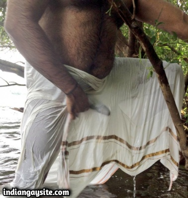 Hairy Indian Bear Bathing in a River in Lungi
