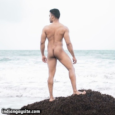 Naked Muscular Hunk Posing & Flexing by the Sea