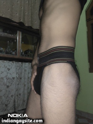 Young & Horny Naked Hunk Showing Bulging Briefs