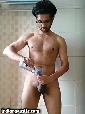 Muscular Gay Hunk Oiling Hard Uncut Cock