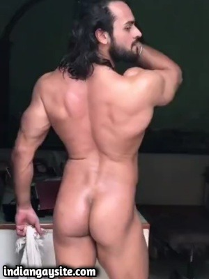 Muscular Indian hunk stripping naked on cam