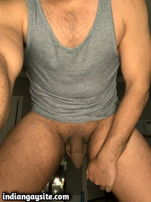 Naked Indian man exposing bare body and cock