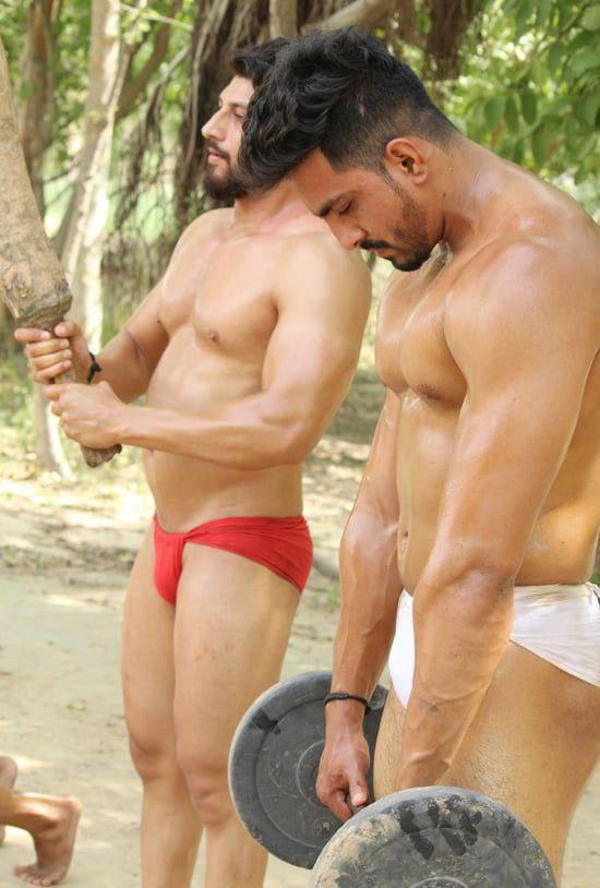Naked muscular hunks flexing in sexy langot