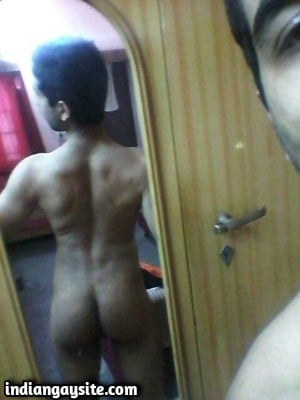 Horny naked hunk shows sexy fit body in mirror