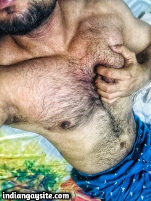 Muscular hairy hunk showing nude body & bulge