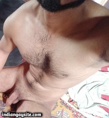 Muscular nude hunk shows big uncut dick