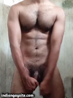 Gay muscle stud wanking rock hard cock