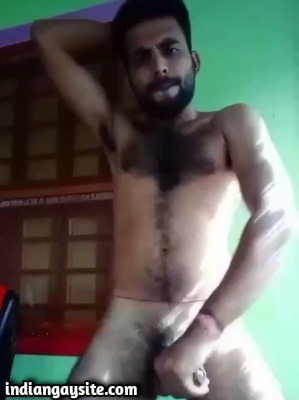 Hairy gay hunk wanking big rock hard cock