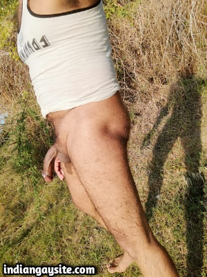 Naked gay exhibitionist having fun outdoors
