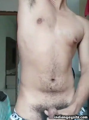 Stripping muscular hunk shows big cock