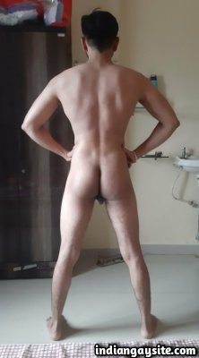 Nude muscle hunk strips from briefs & shows ass
