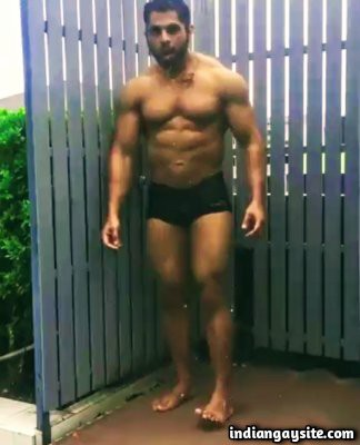 Outdoor gay video of a sexy hunk bathing in shorts
