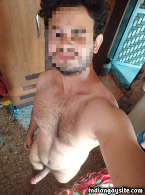 Nude muscular man showing big circumcised cock