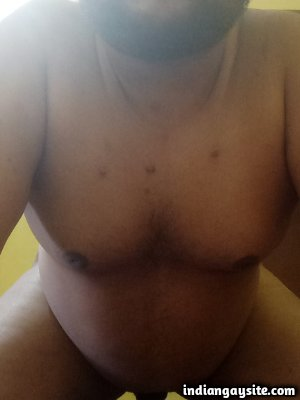Naked chubby man shows curvy body eagerly