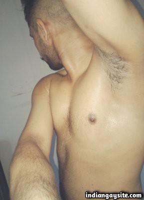 Naked horny hunk showing off big boner