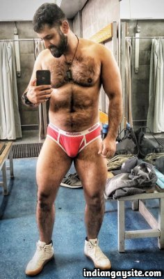 Hairy muscle hunk shows sexy body in bulging briefs