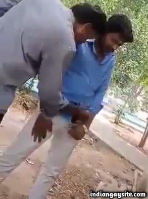 Public gay handjob of horny strangers in a park