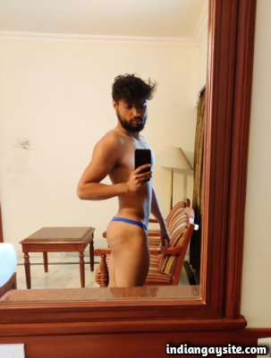 Horny muscular hunk teasing sexy body in undies
