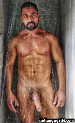 Naked hunky model posing bare and rock hard