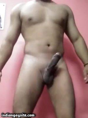 Stripping horny hunk rubbing big dick on cam