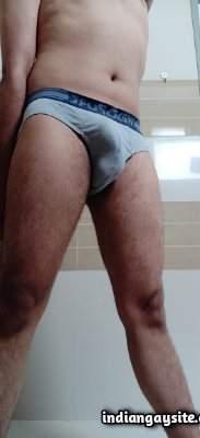 Naked horny man sporting his big uncut boner