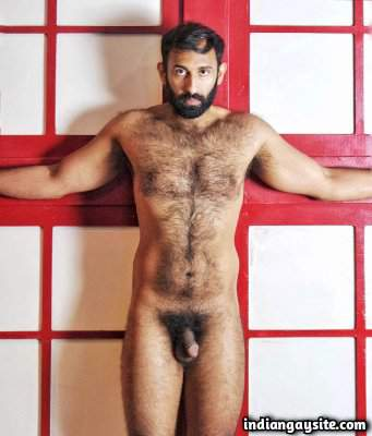 Hairy naked bear showing off his furry body