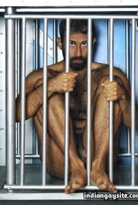 Naked hairy bear in bondage gay photoshoot