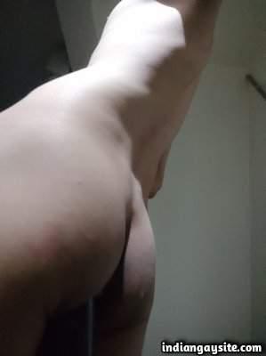 Stripping nude boy teasing sexy bare body