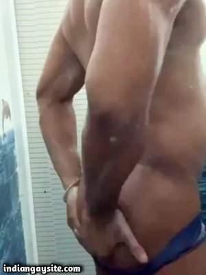 Stripping desi man teasing wet ass in shower
