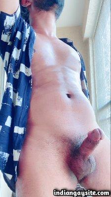 Indian horny hunk teasing his big rock hard dick