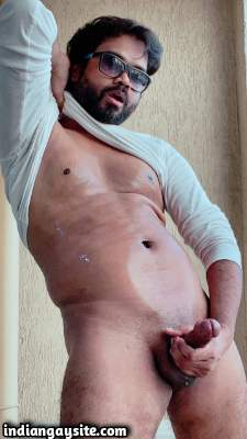 Horny Indian man teasing big dick in nude pics